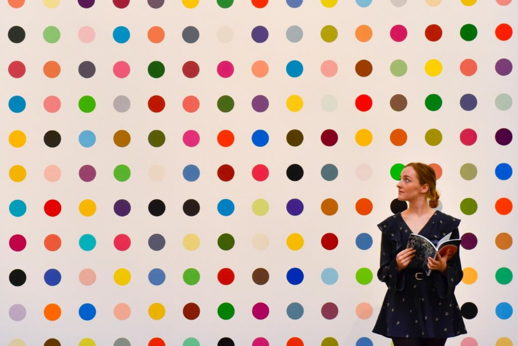 """JE8333 London, UK. 23rd June, 2017. A staff member views """"1-Heptene"""", 2004-2011, by Damien Hirst (estimate GBP0.5-0.7m at the preview of Sotheby's Contemporary Art Sale in New Bond Street. The auction, which is dominated by Pop art, takes place on 28 June. Credit: Stephen Chung/Alamy Live News"""