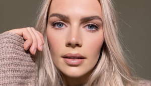 blond woman with blue eyes and strong eyebrows