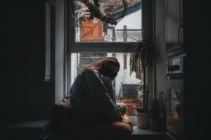 woman worrying by the window