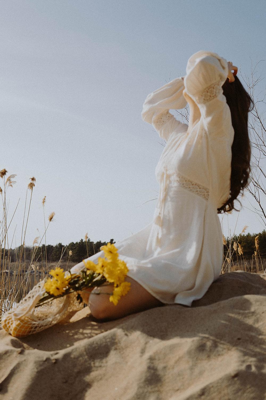 woman beach flowers