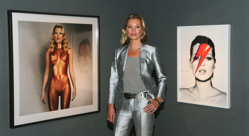 LONDON, UNITED KINGDOM - SEPTEMBER 04: Kate Moss poses at a photocall ahead of the 'Kate Moss: The Collection' auction which sees various artworks of the model curated by Gert Elfering go under the hammer at Christie's King Street on September 4, 2013 in London, England. (Photo by Stuart C. Wilson/Getty Images)