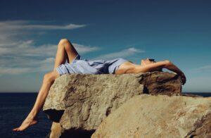 woman by the sea blue dress maria lupan