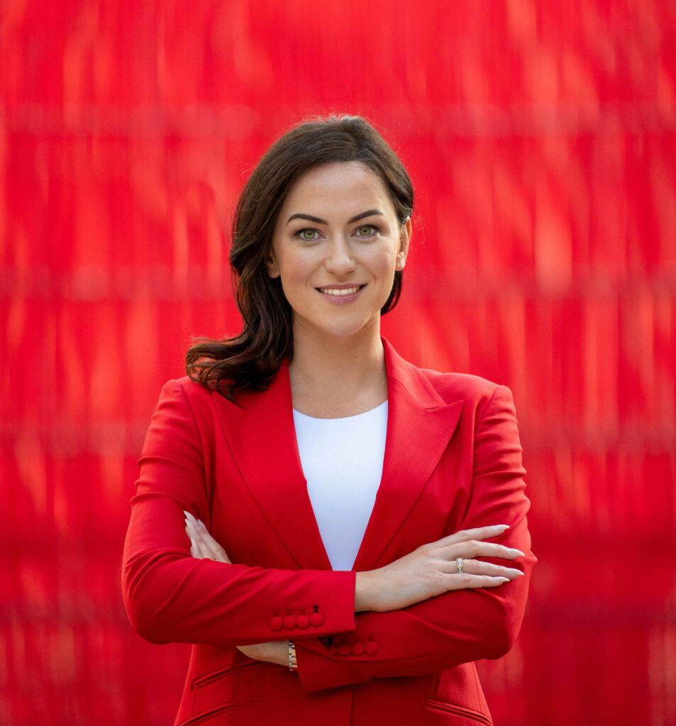 Laura Tynan red background
