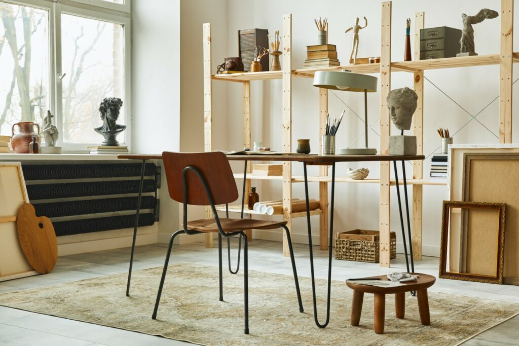 Unique,Artist,Workspace,Interior,With,Stylish,Desk,,Wooden,Easel,,Bookcase,