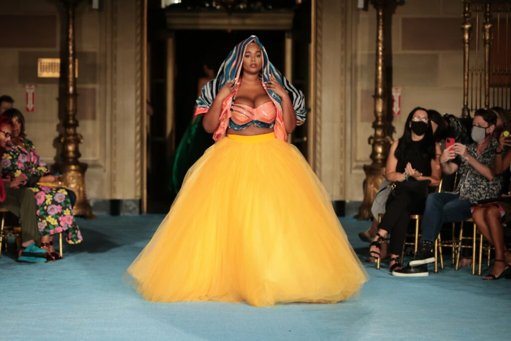 NEW YORK, NEW YORK - SEPTEMBER 07: Model Precious Lee walks the runway for the Christian Siriano SS2022 Fashion Show at Gotham Hall on September 07, 2021 in New York City (Photo by Mike Coppola/Getty Images for Christian Siriano)