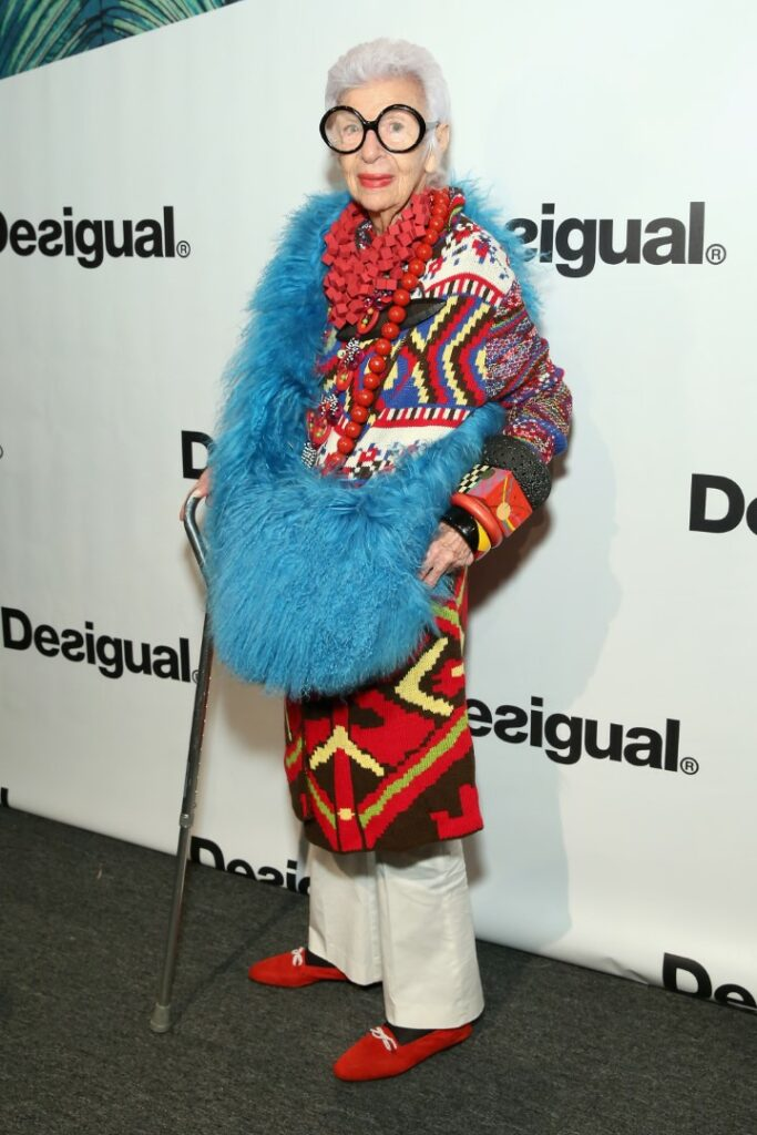 NEW YORK, NY - SEPTEMBER 10: Businesswoman Iris Apfel poses backstage at the Desigual fashion show during Spring 2016 New York Fashion Week: The Shows at The Arc, Skylight at Moynihan Station on September 10, 2015 in New York City. (Photo by Cindy Ord/Getty Images for NYFW: The Shows)