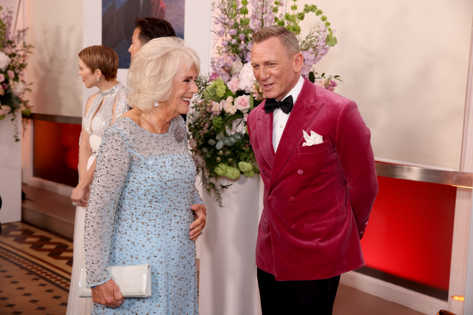 """LONDON, ENGLAND - SEPTEMBER 28: Camilla, Duchess of Cornwall meets some of the cast including Daniel Craig at the World Premiere of """"NO TIME TO DIE"""" at the Royal Albert Hall on September 28, 2021 in London, England. (Photo by Tim P. Whitby/Getty Images for EON Productions, Metro-Goldwyn-Mayer Studios, and Universal Pictures )"""